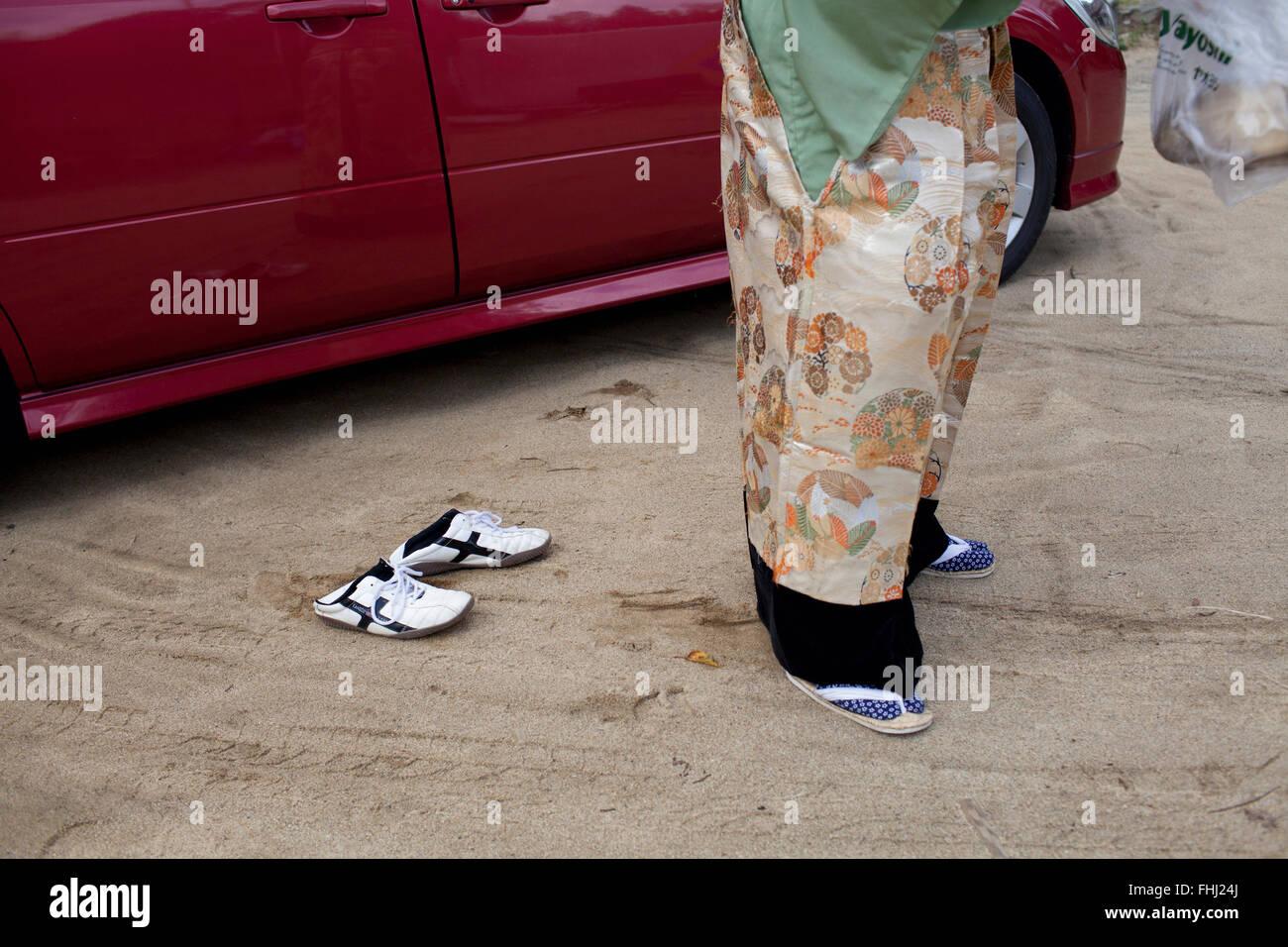 The Fukushima samurais -  Japan / Fukushima  -  Nomaoi Samurai Warrior changing modern shoes to Japanese sandals. - Stock Image