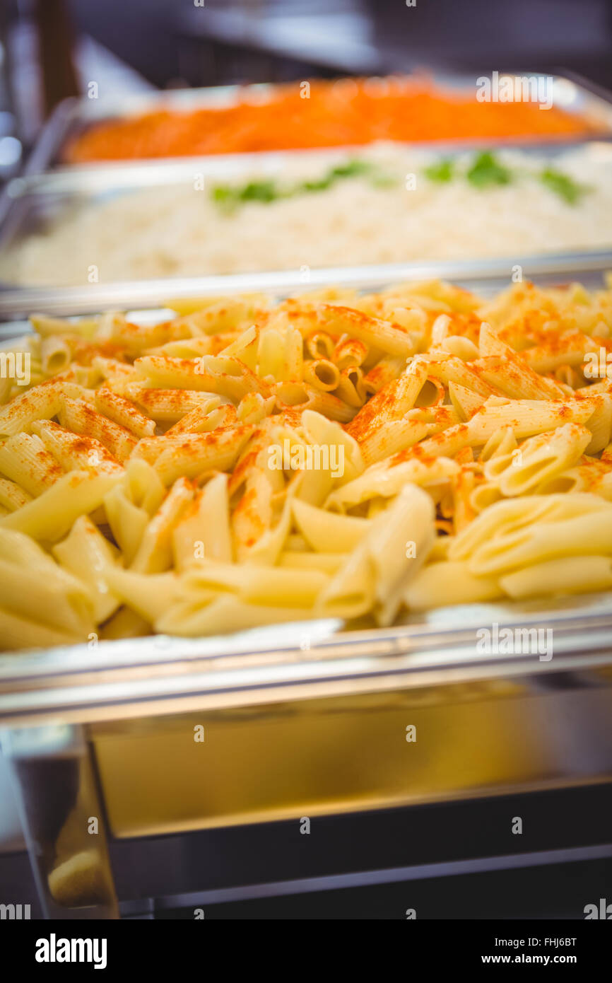 Serving dishes of potato and pasta - Stock Image