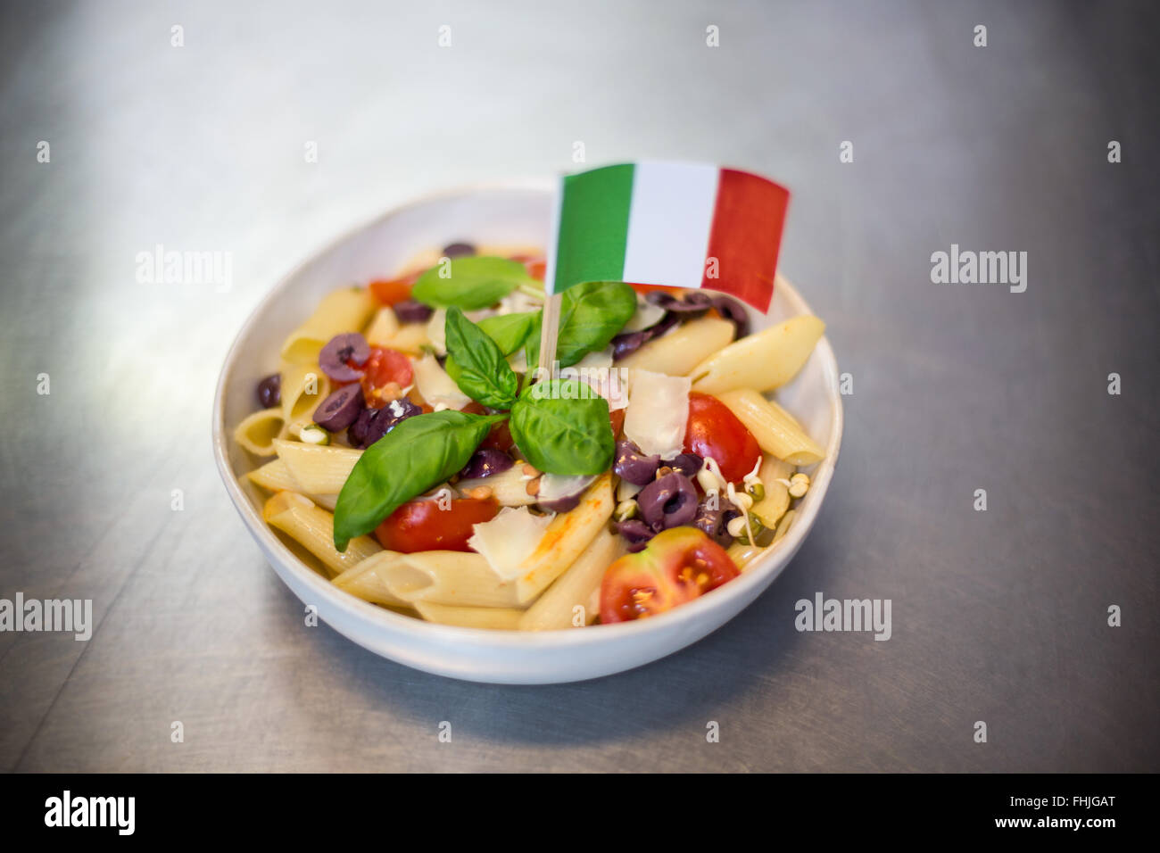 Bowl of pasta with italian flag - Stock Image