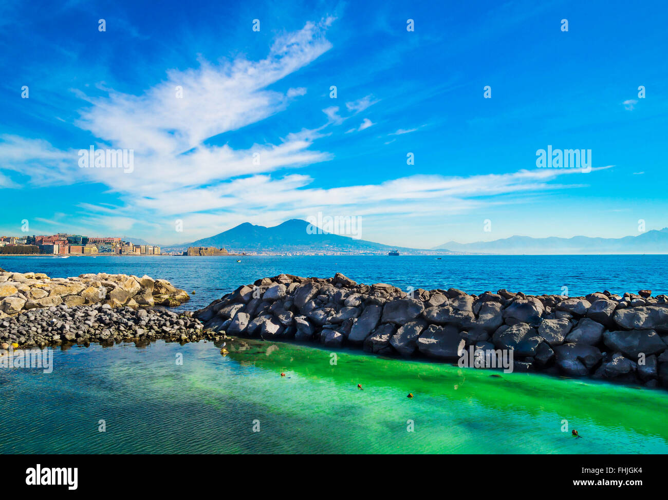 Morning view of Gulf of Naples with blue sky ,Mediterranean sea and Vesuvius Volcano at the background - Stock Image