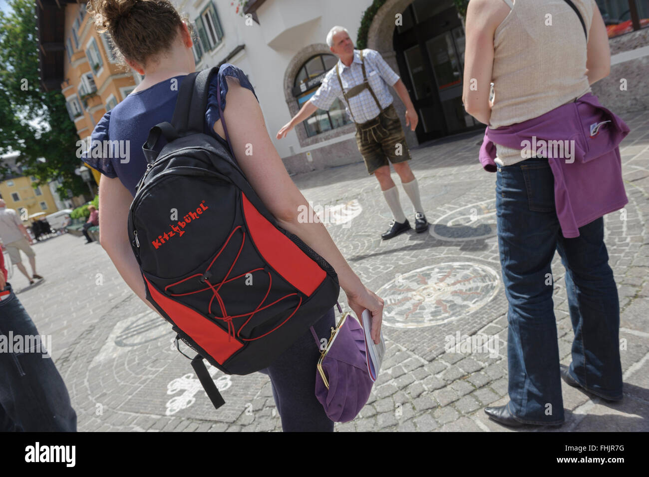 Tour guide in tradition Austrian Lederhosen leather shorts. Kitzbühel town center. Austria. Europe - Stock Image