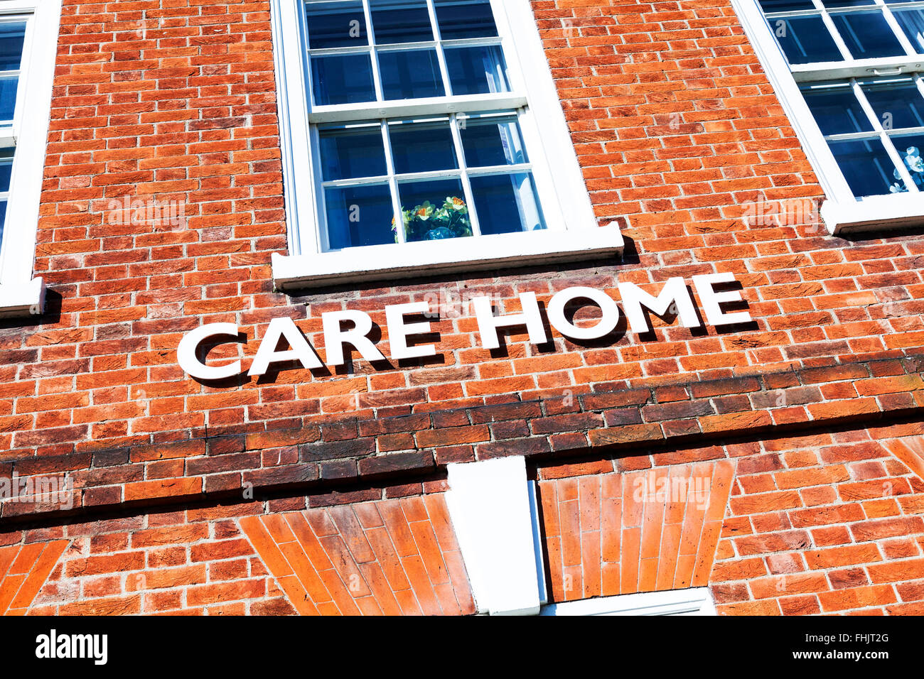 Care Home oap elderly sign old aged pensioner homes exterior logo UK England - Stock Image