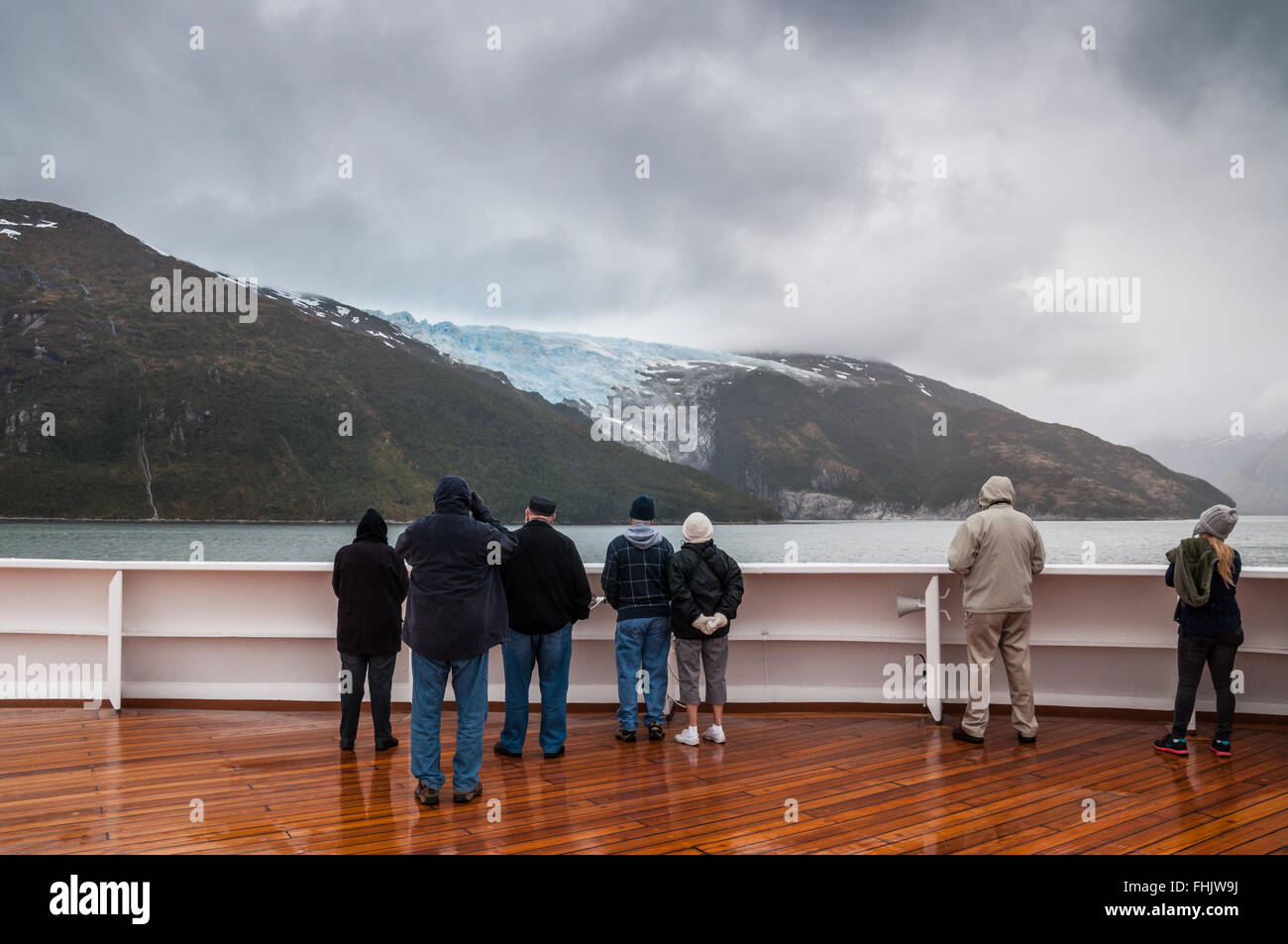 Passengers on board the cruise ship Veendam viewing beautiful Romanche Glacier - Stock Image