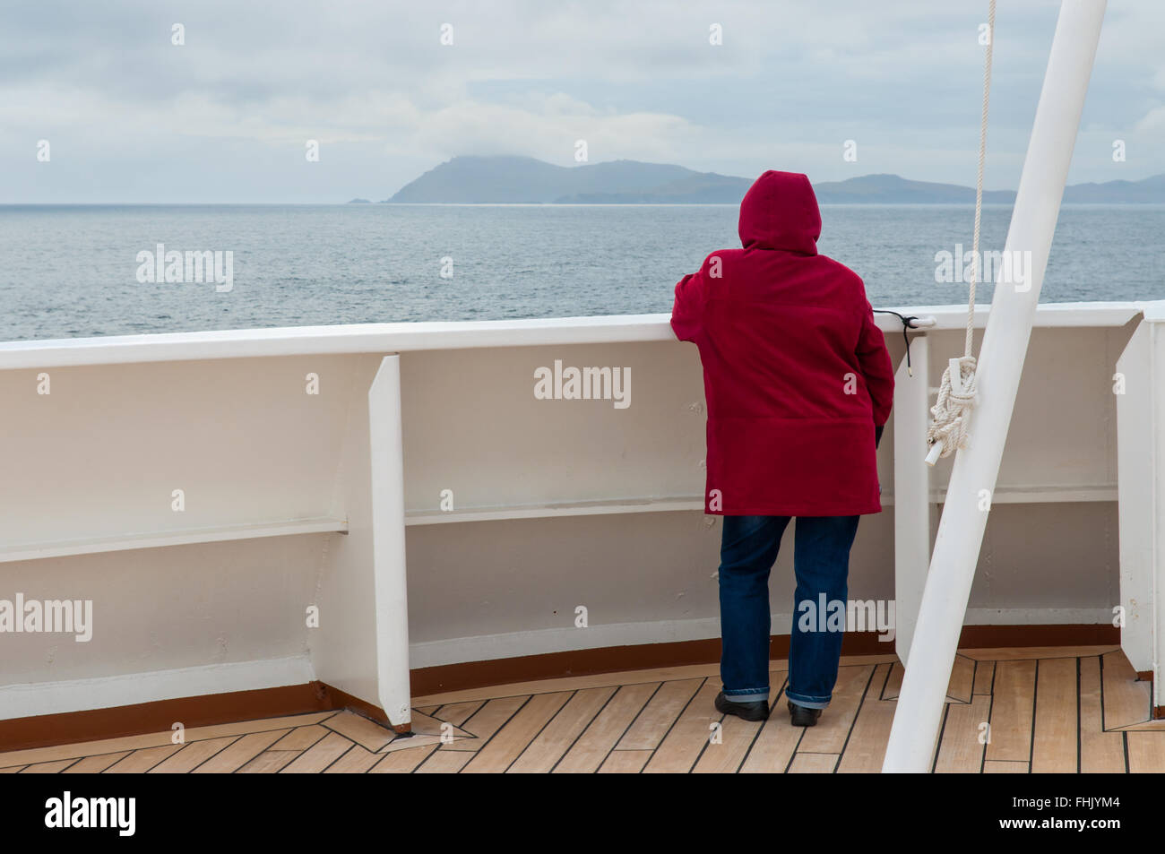 Cape Horn, Chile - December 11, 2012: Passenger on board the cruise ship Veendam looking forward on the bow on Cape - Stock Image