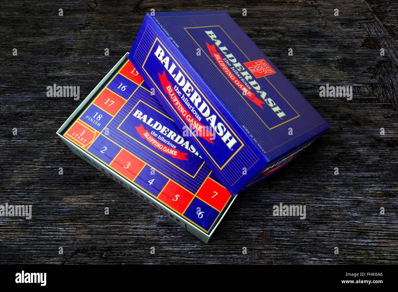 Balderdash bluffing board game on a wooden background Stock Photo