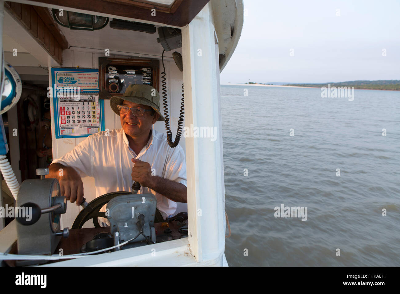 Idelfonso Taketomi of Vento em Popa tourism in his Amazon river boat on the Tapajos river - Stock Image