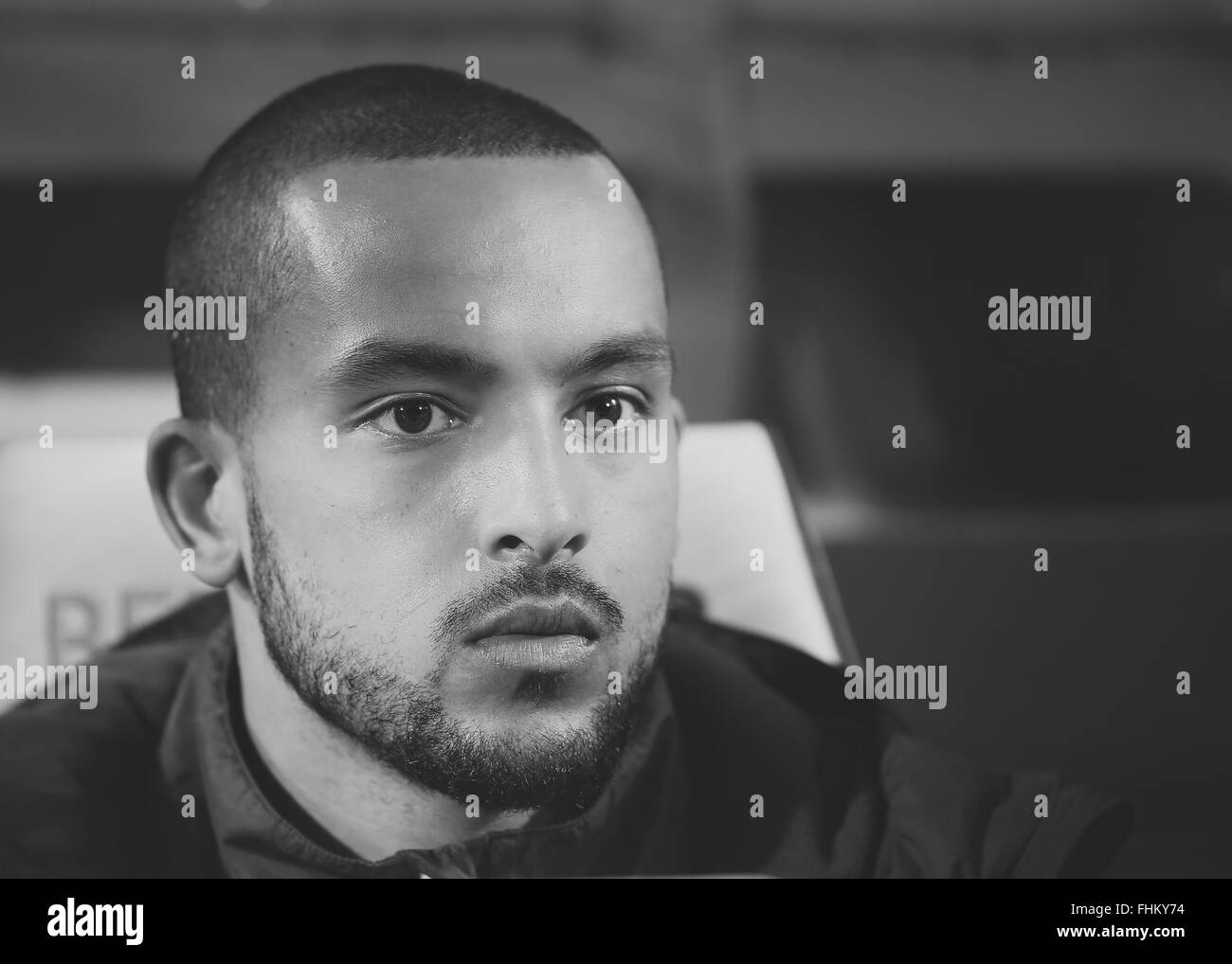 Arsenal's Theo Walcott, watches his side take on QPR at Loftus Road on March, 4, 2015. - Stock Image
