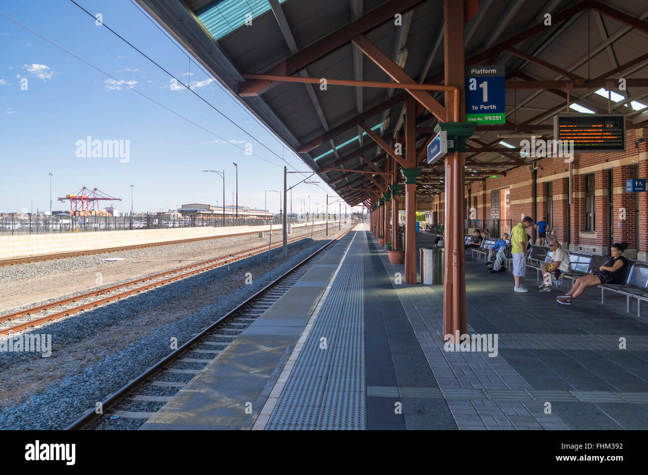 Platform 1 of Fremantle railroad station. Commuters waiting for Transperth train to Perth. Fremantle, Western Australia. - Stock Image