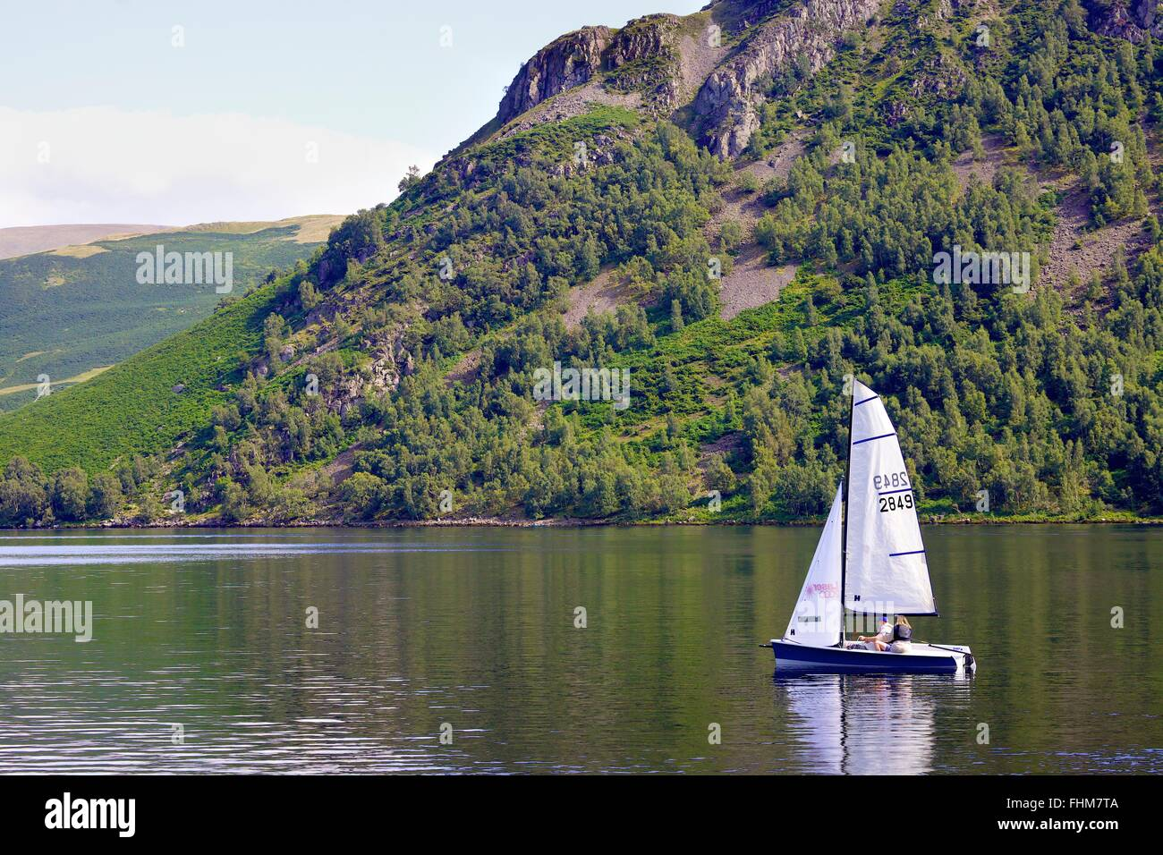 Lake District National Park. Dinghy sailing on lake Ullswater. - Stock Image