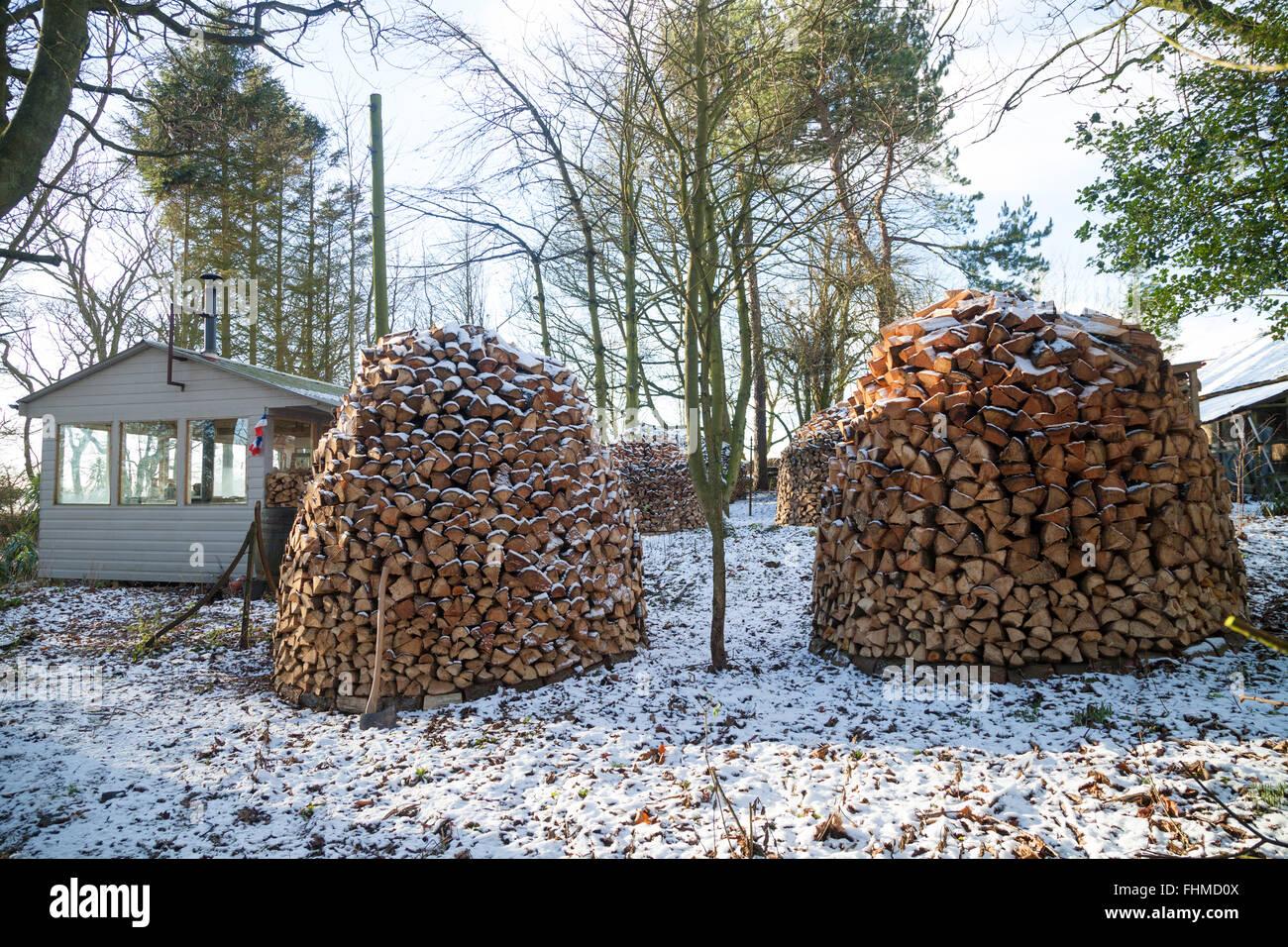 Holz Hausen Wood Stacks In A Garden In Fife Scotland Stock Photo
