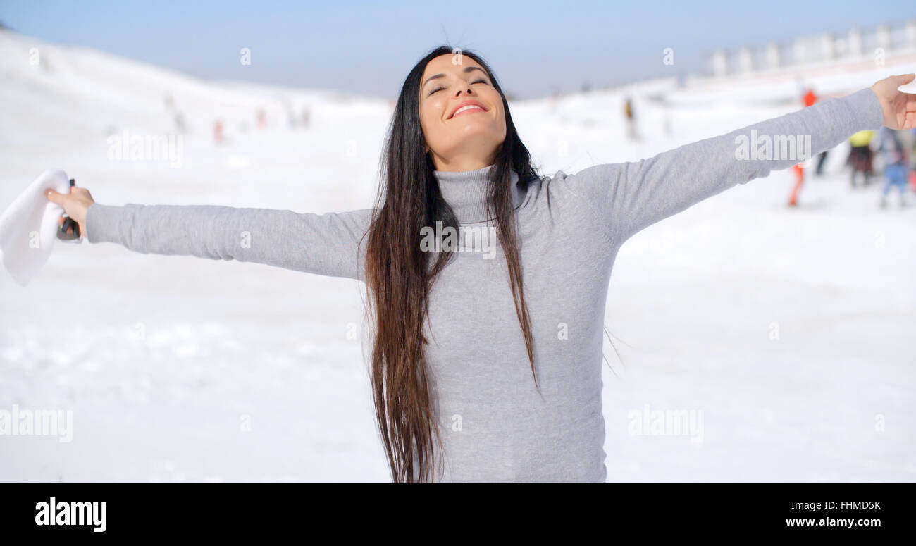 Young woman rejoicing in the winter weather Stock Photo