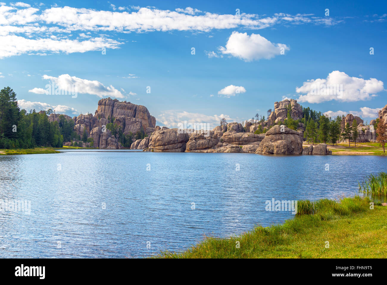 Dramatic rock formations on the shore of Sylvan Lake in Custer State Park - Stock Image