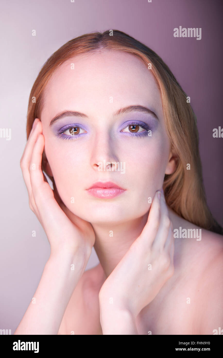 A woman wearing purple eyeshadow - Stock Image