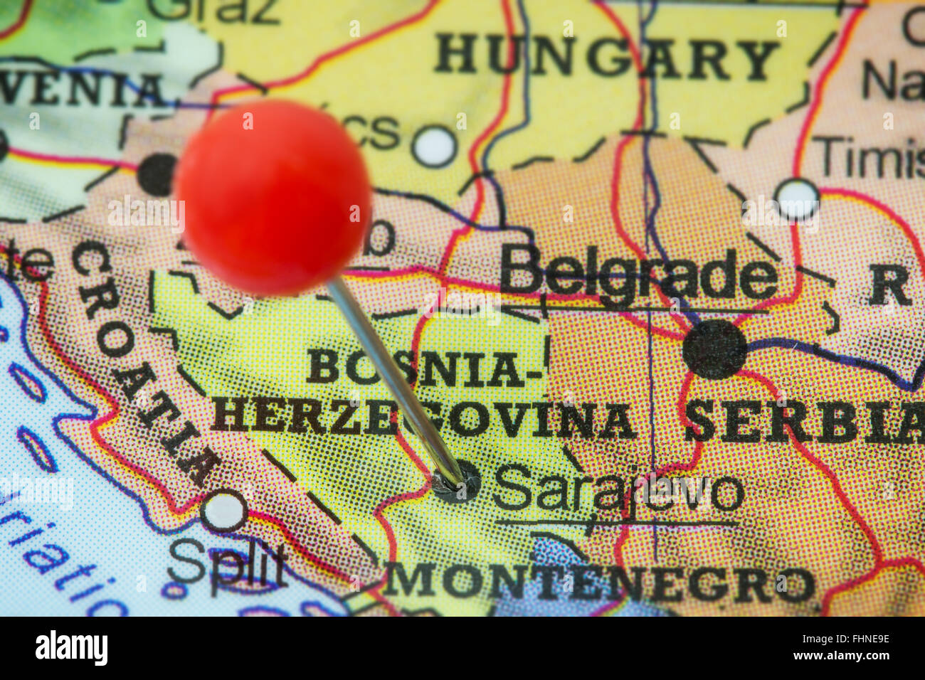Close-up of a red pushpin in a map of Sarajevo, Bosnia and Herzegovina. - Stock Image