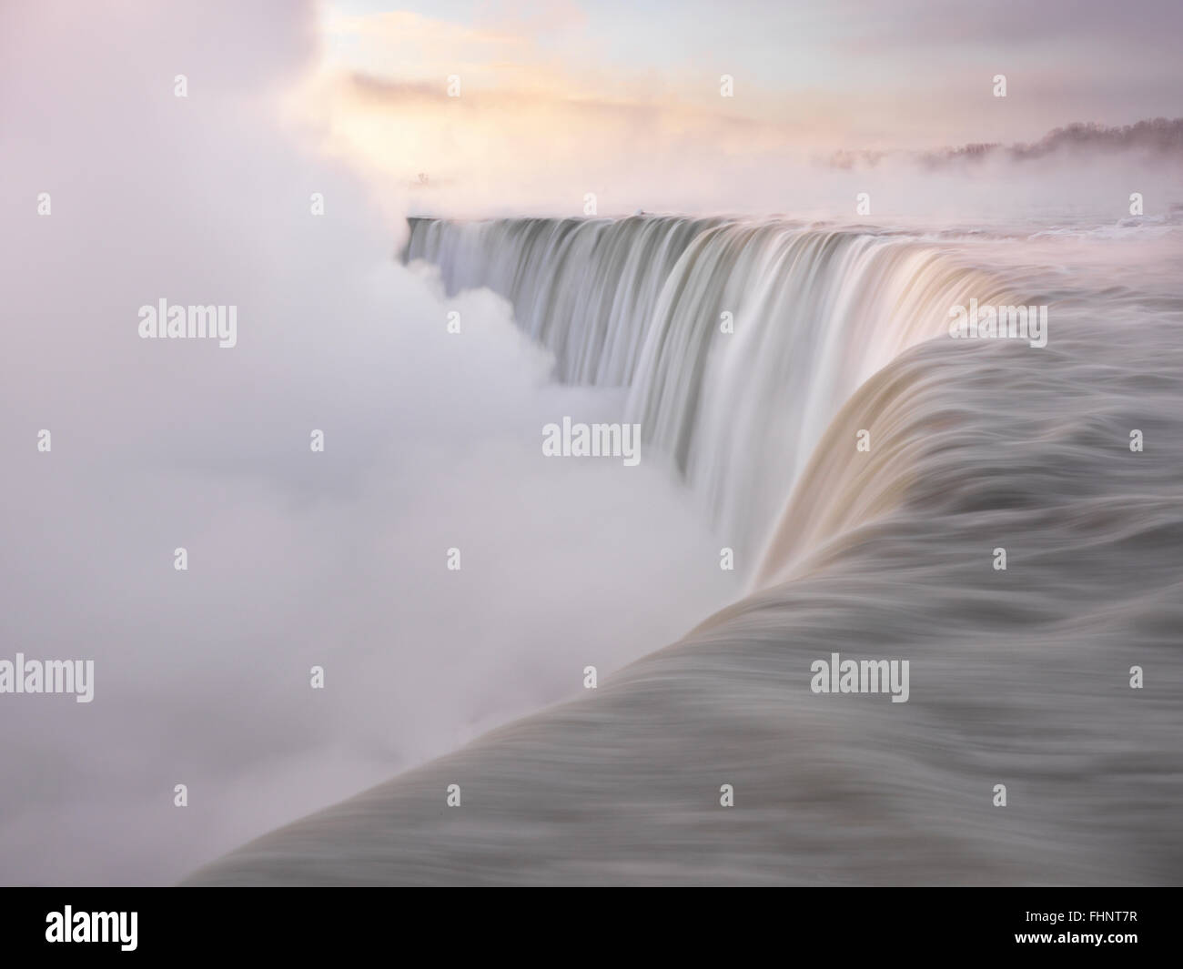 Brink of Niagara Falls Canadian Horseshoe beautiful sunrise scenery in soft light pastel colors, wintertime scenic. Stock Photo