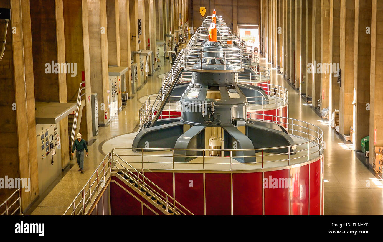 A worker walks through the powerplant at Hoover Dam - Stock Image