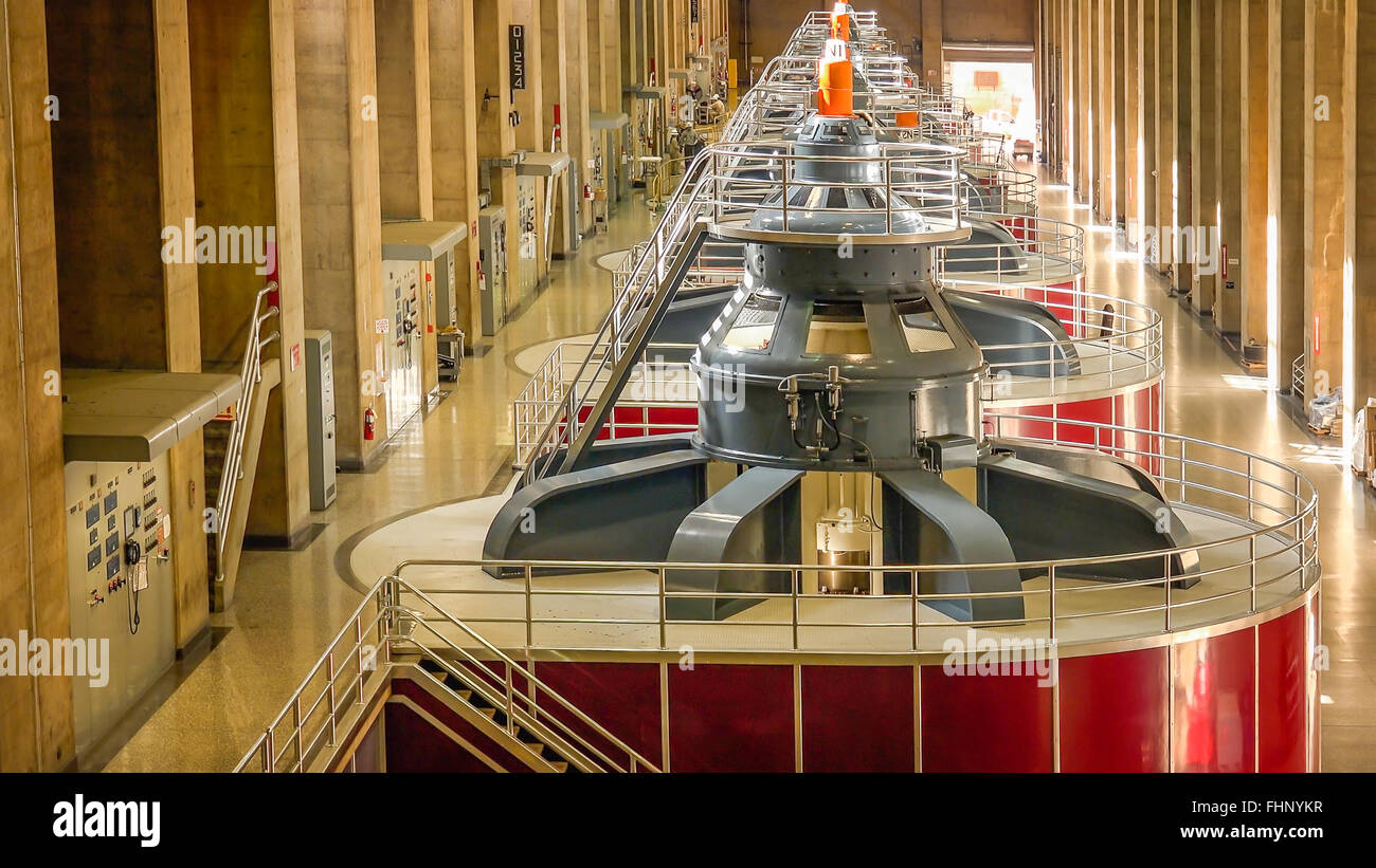 Large turbines spin to create electricity in the powerplant at Hoover Dam - Stock Image