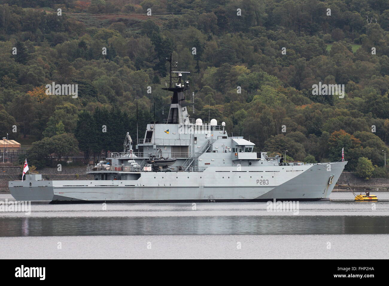 HMS Mersey (P283), a River-class patrol vessel of the Royal Navy, sits at anchor in the Gare Loch before Joint Warrior - Stock Image