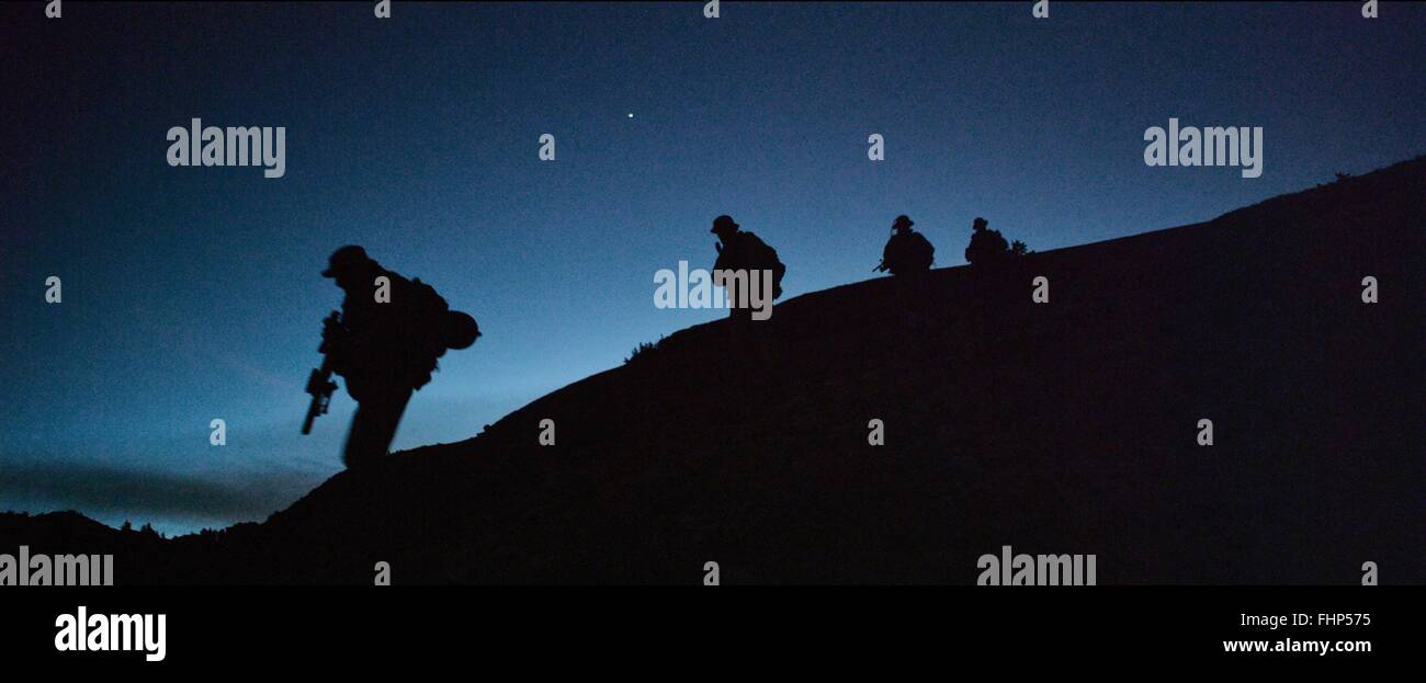 SCENE WITH SOLDIERS SILOUETTES LONE SURVIVOR (2013) - Stock Image