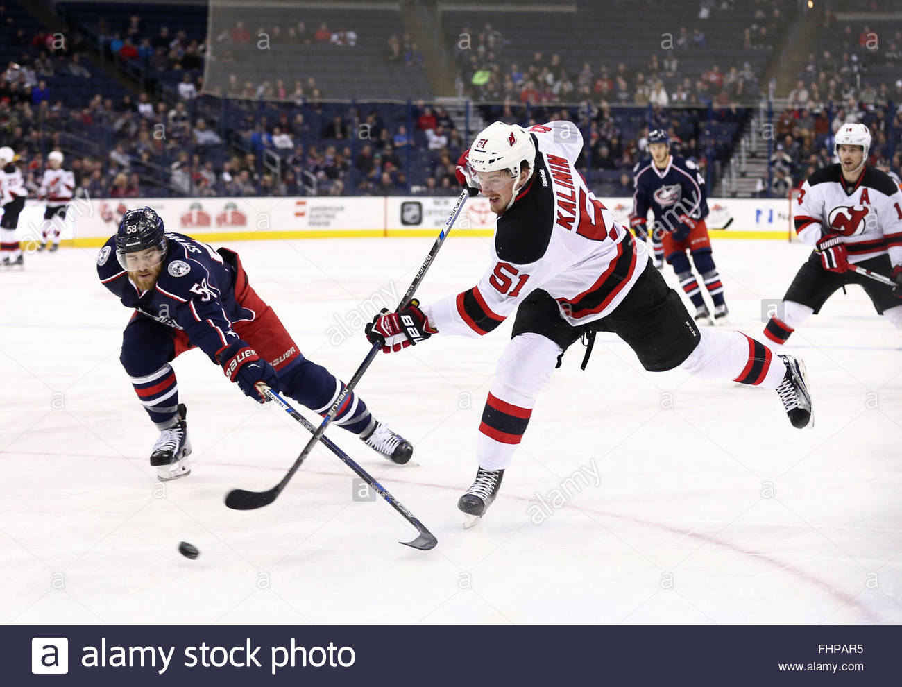 Columbus, Ohio, USA. 25th Feb, 2016. Columbus Blue Jackets defenseman David Savard (58) defends against New Jersey - Stock Image