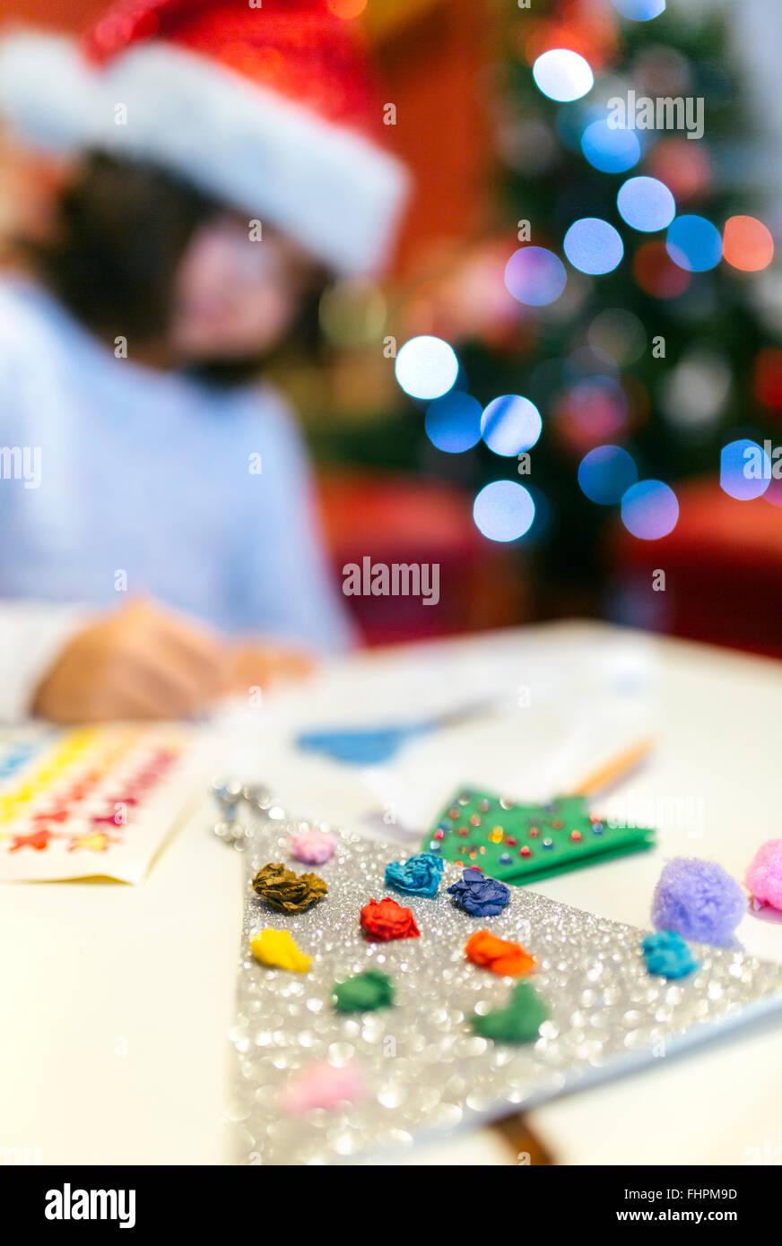 Lttle girl tinkering Christmas decoration, close-up - Stock Image