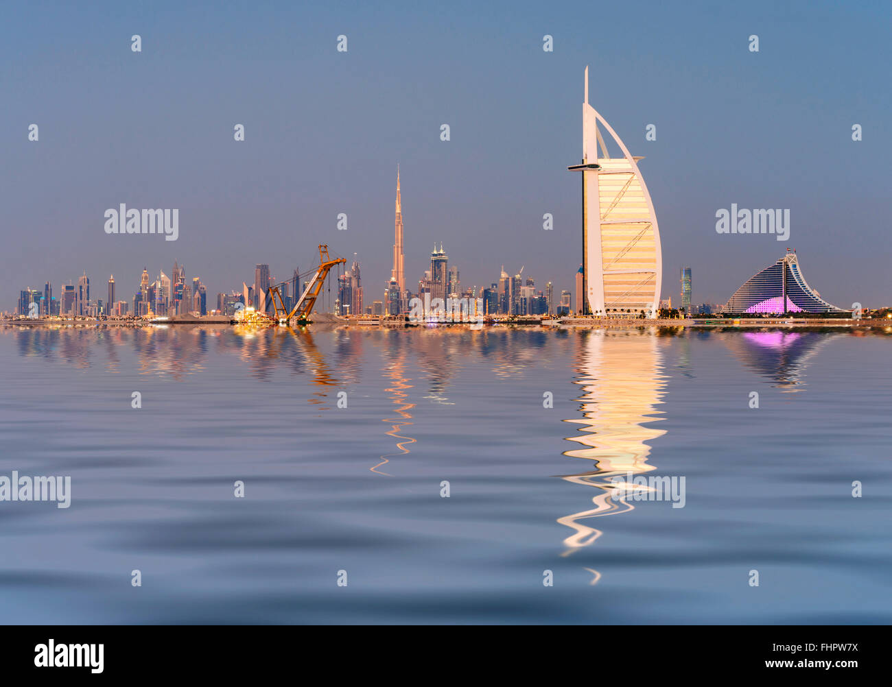 Skyline of Dubai waterfront with Burj al Arab Hotel in United Arab Emirates - Stock Image