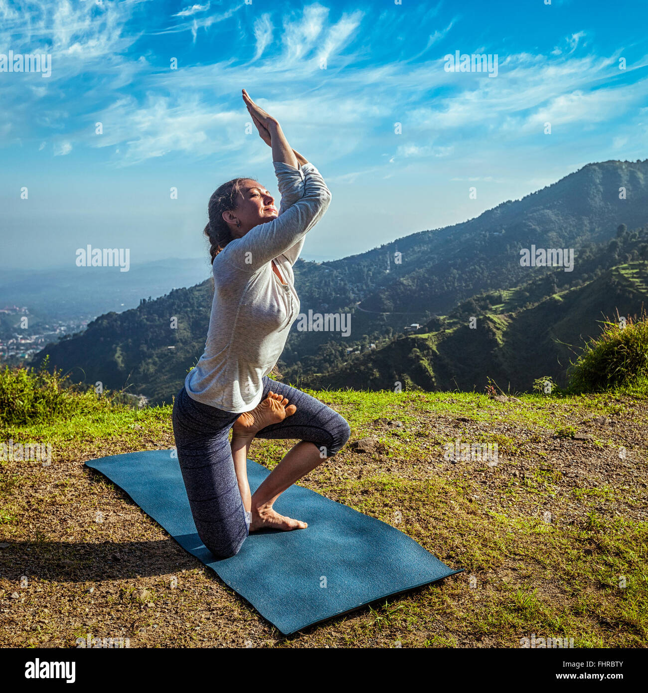 Young woman doing yoga advanced asana - Stock Image
