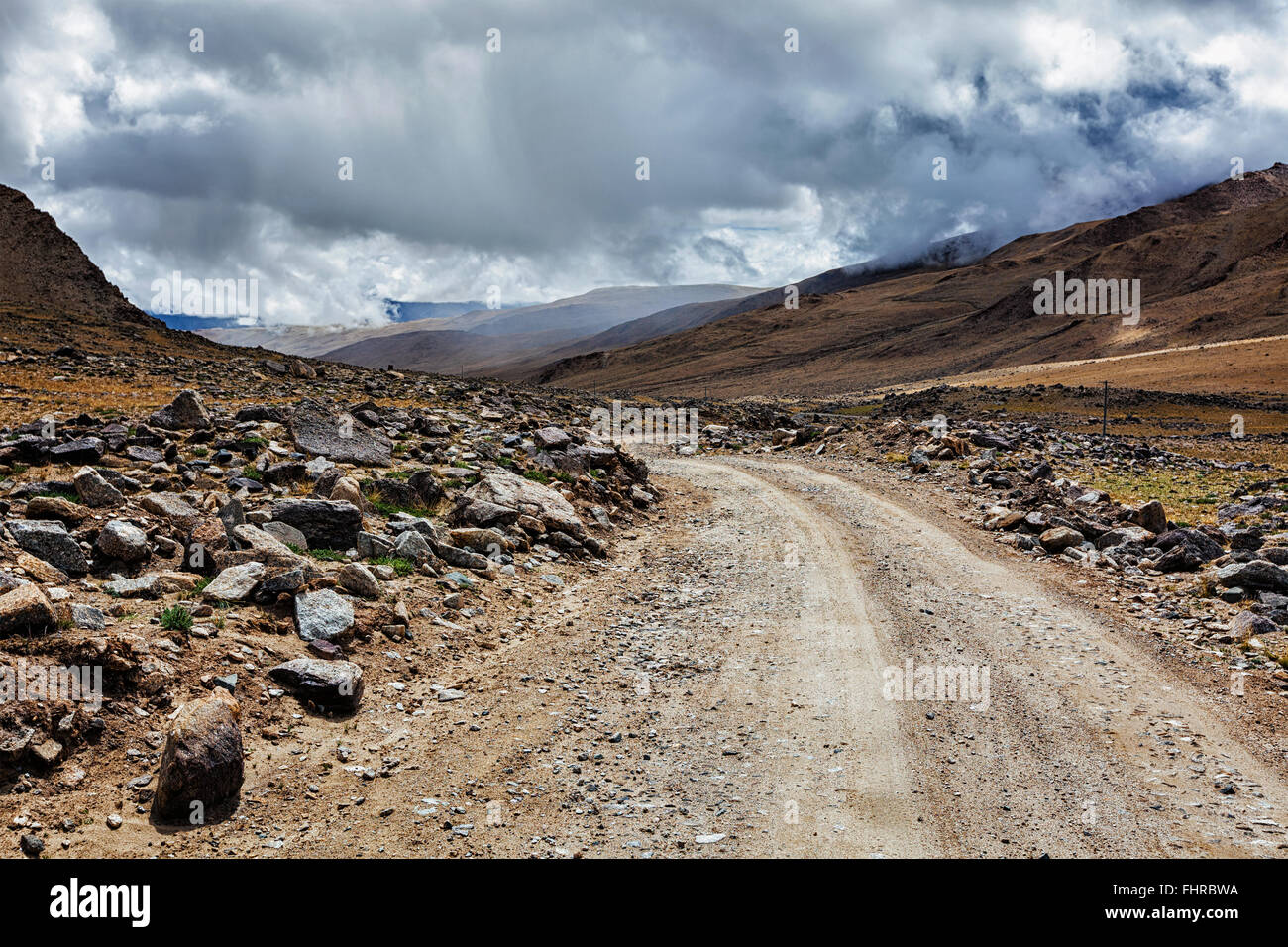 Dirt road in Himalayas - Stock Image