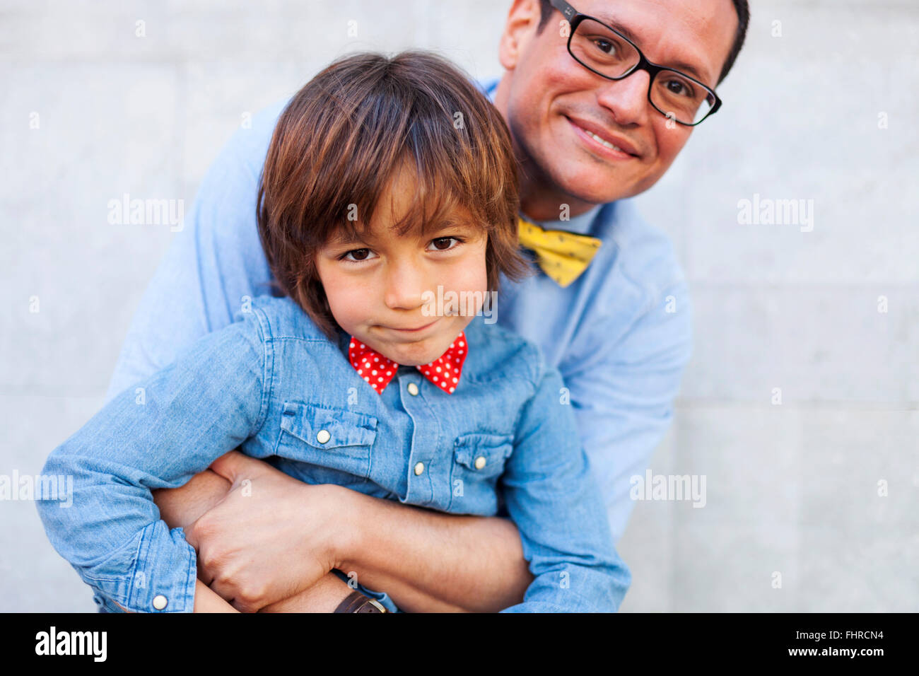 Father and son wearing bow ties, portrait - Stock Image