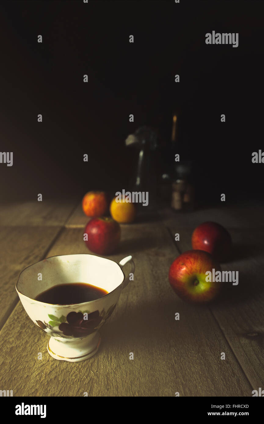 still life with a cup of coffee and apples on wooden table Stock Photo