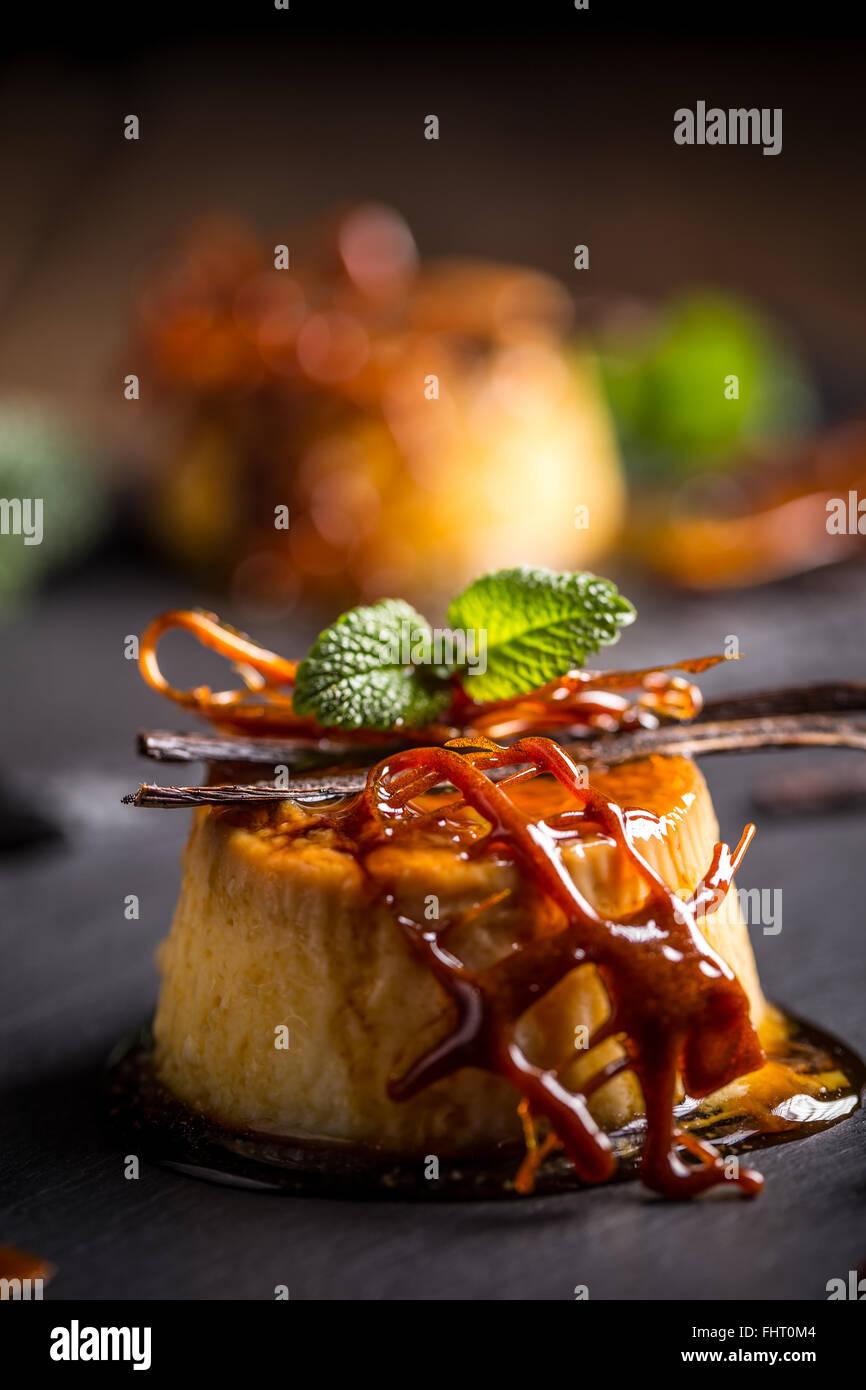Creme caramel decorated with caramel lattice - Stock Image