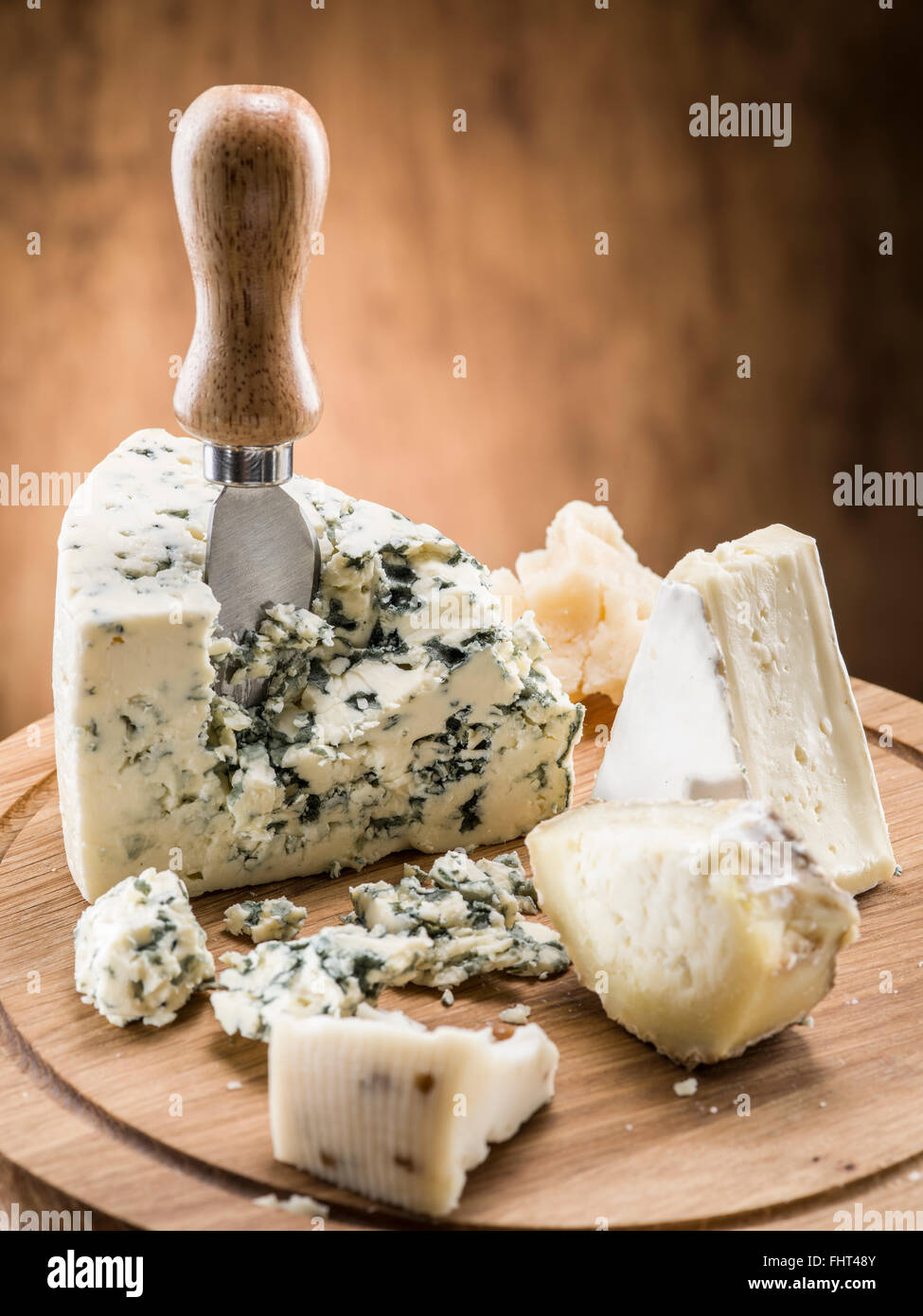 Danish blue cheese on a wooden board. - Stock Image
