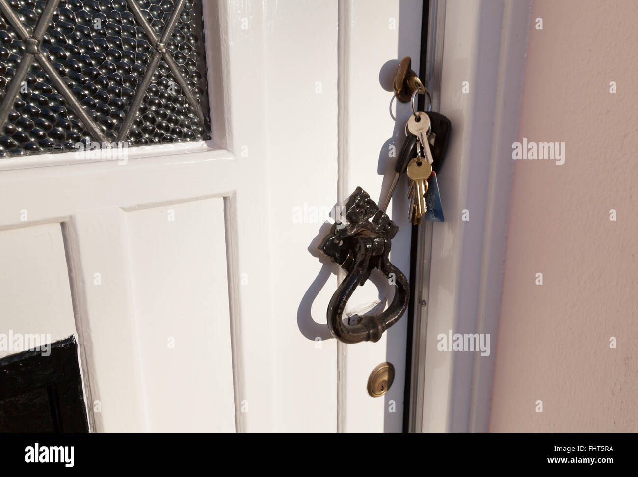 A house door with forgotten keys left in the lock, UK - Stock Image