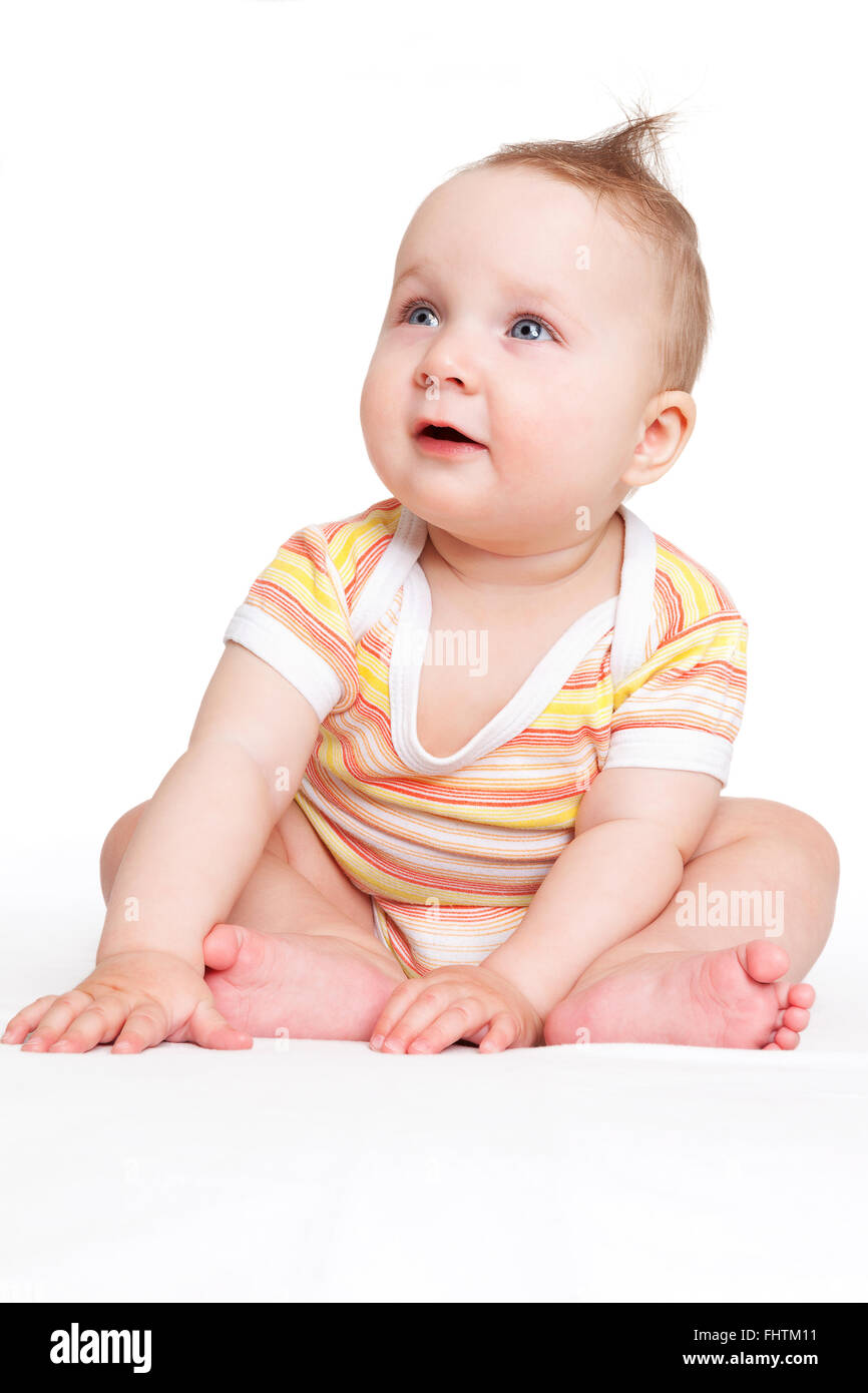 Cute baby sitting isolated. - Stock Image