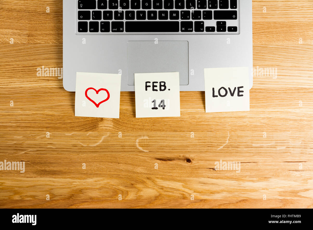 Valentine's Day concept office remember postit - Stock Image