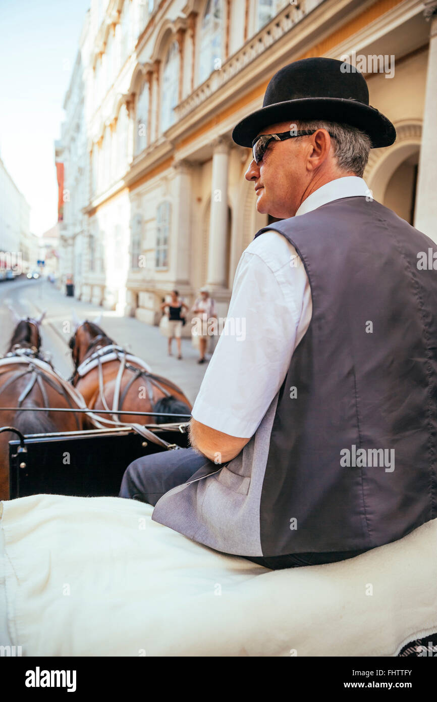 Austria, Vienna, coachman on his fiaker in the city - Stock Image