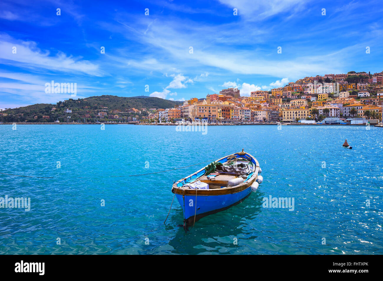 Wooden small old boat in Porto Santo Stefano seafront, italian travel destination. Monte Argentario, Tuscany, Italy. - Stock Image