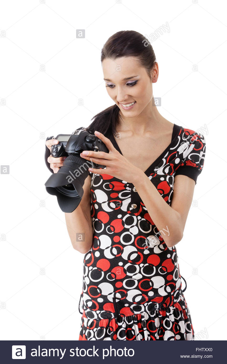 woman photographed on reflex camera - Stock Image