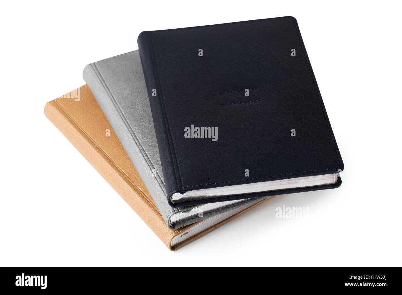 Pile of leather hardcover business diaries isolated on white background. Black, gray and beige notebooks - Stock Image