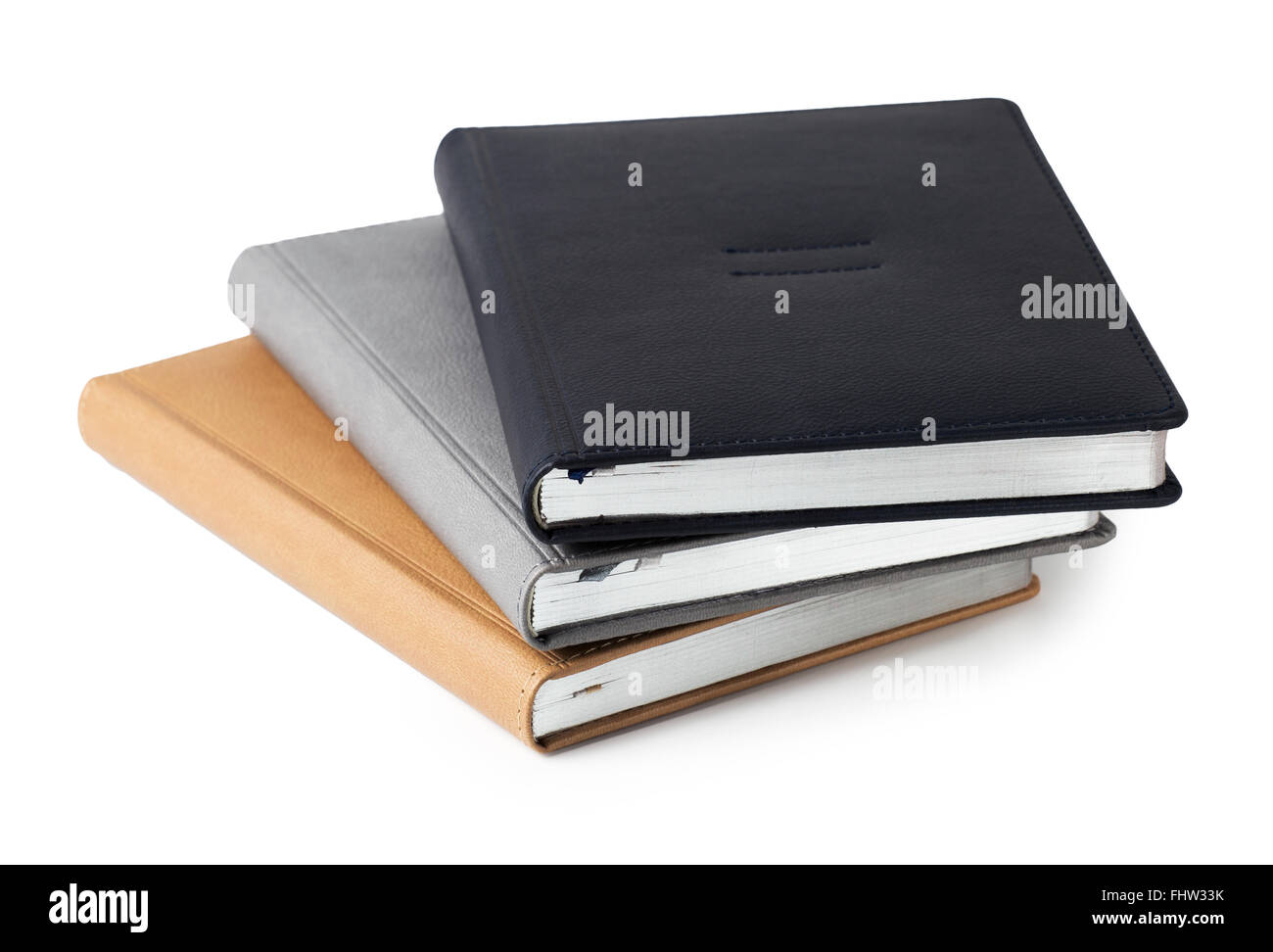 Assorted business hardcover leather diaries isolated on white background - Stock Image