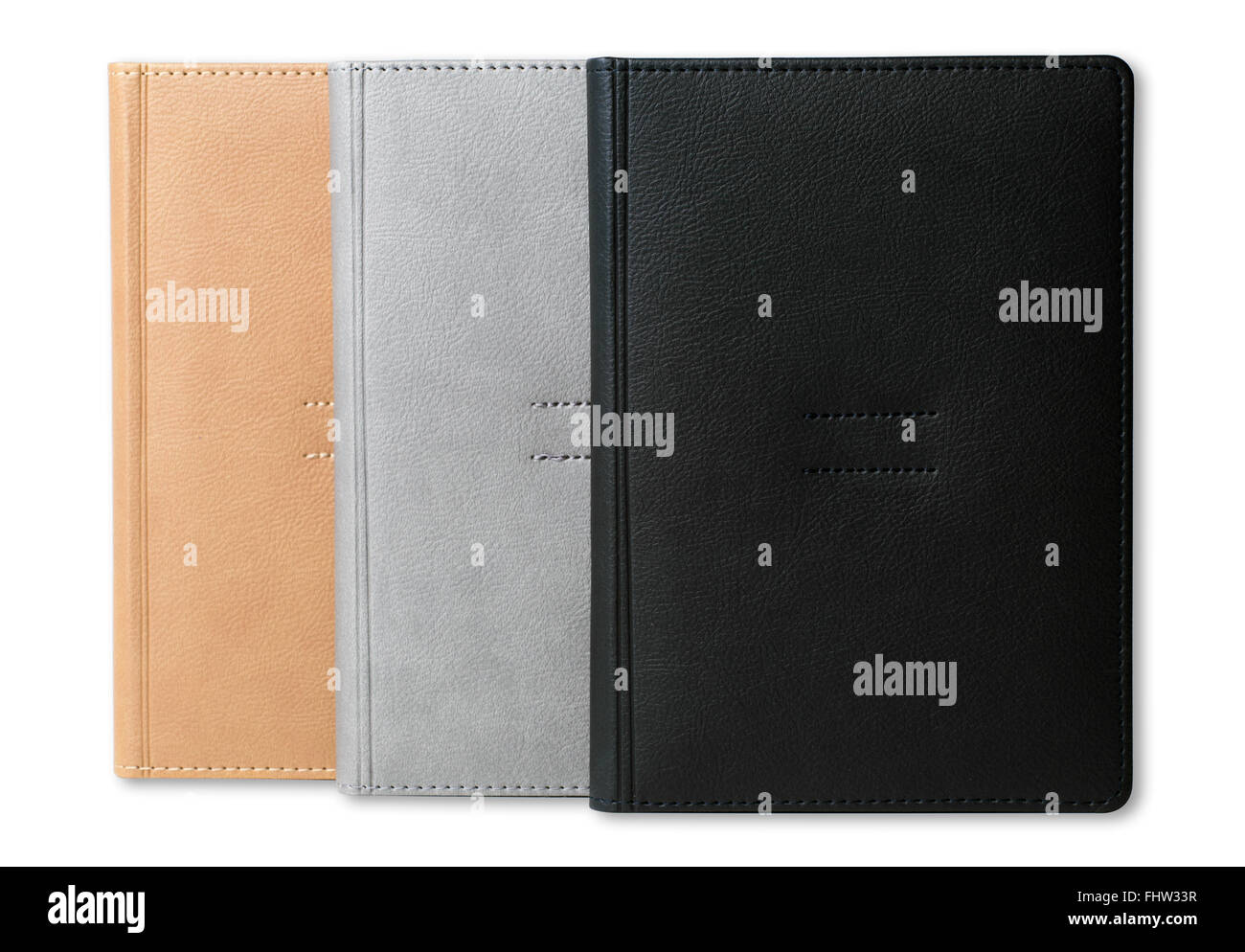 Assorted hardcover leather office diaries isolated on white background - Stock Image