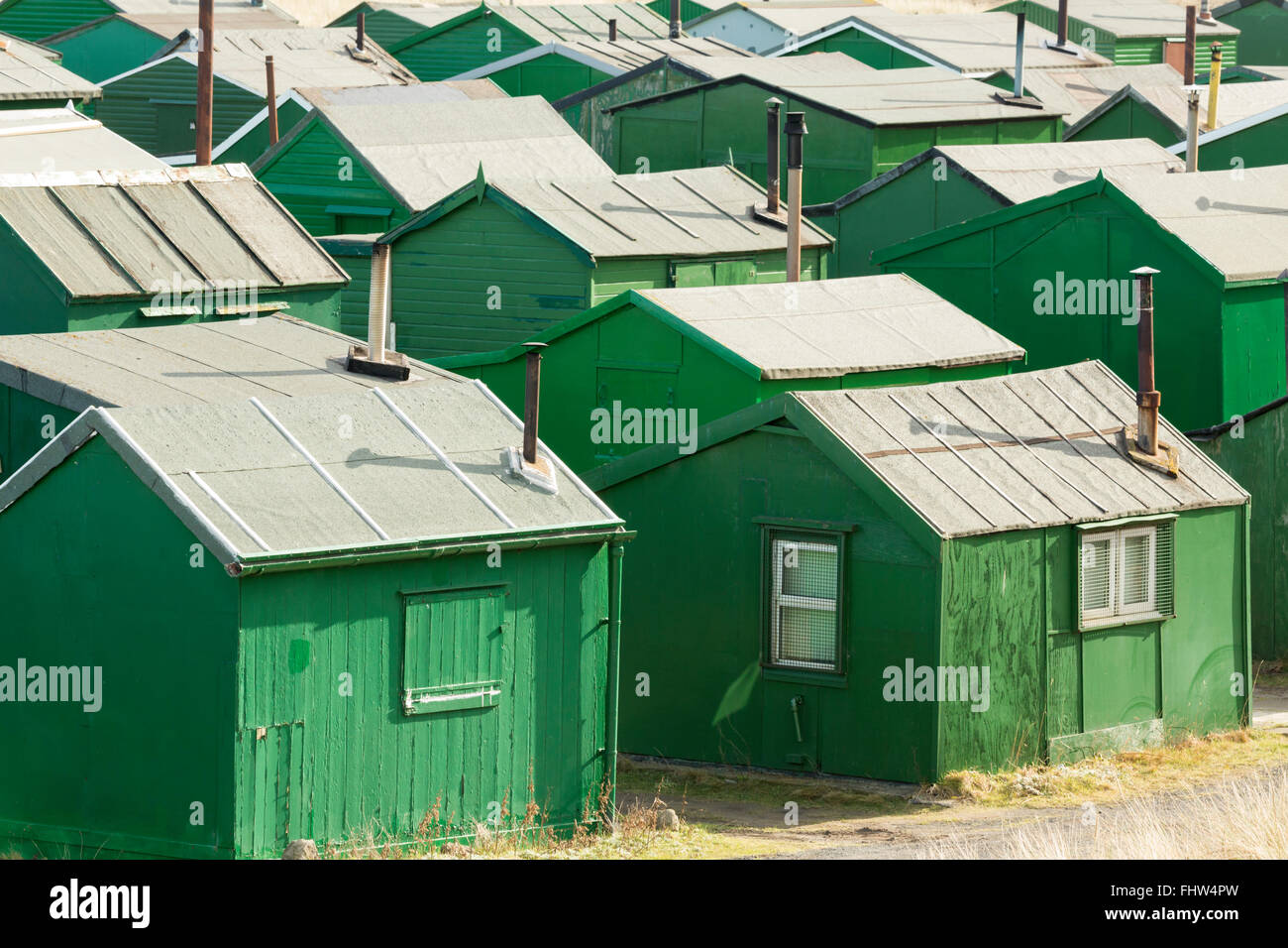 Fisherman's Association huts in the sand dunes at South Gare, Redcar and Cleveland, February 2016. - Stock Image