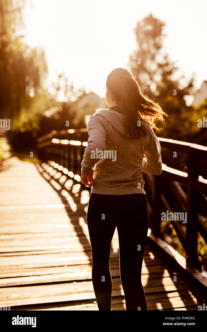 Female jogger exercising outdoors in nature - Stock Image
