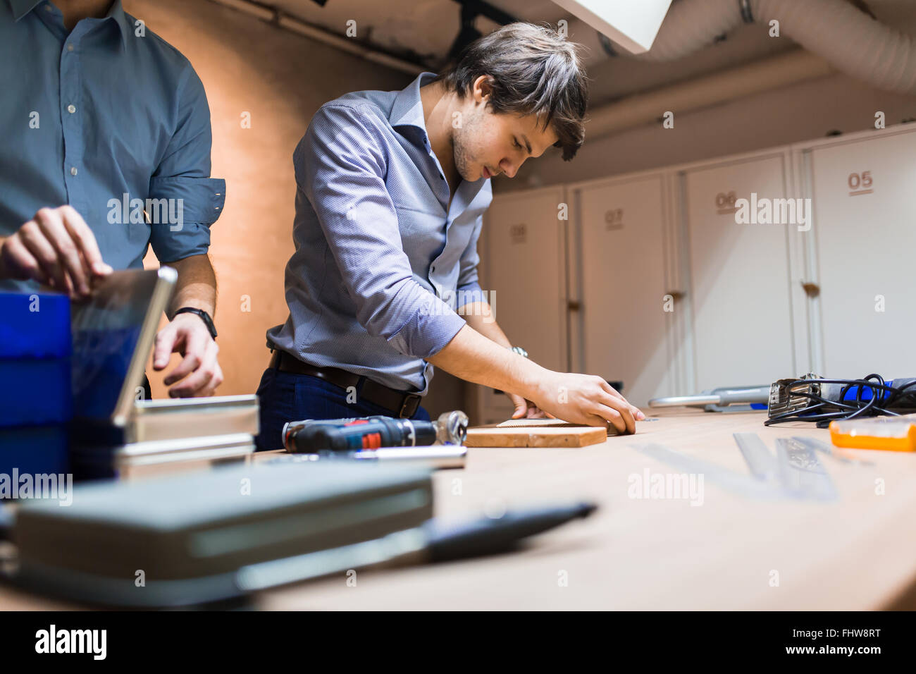 Handyman working with wood with precision tools at hand - Stock Image