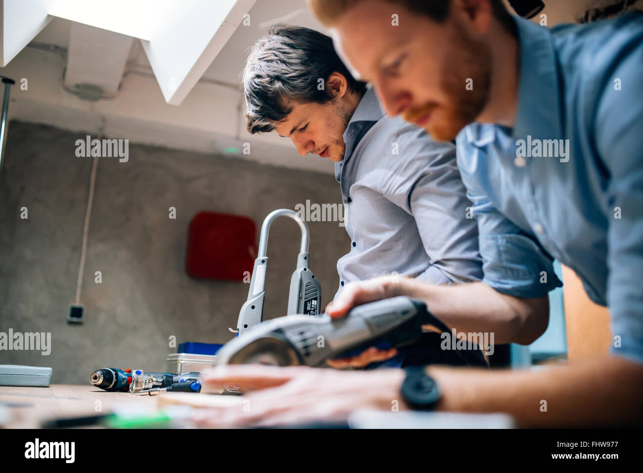 Joiners working with wood and being creative - Stock Image