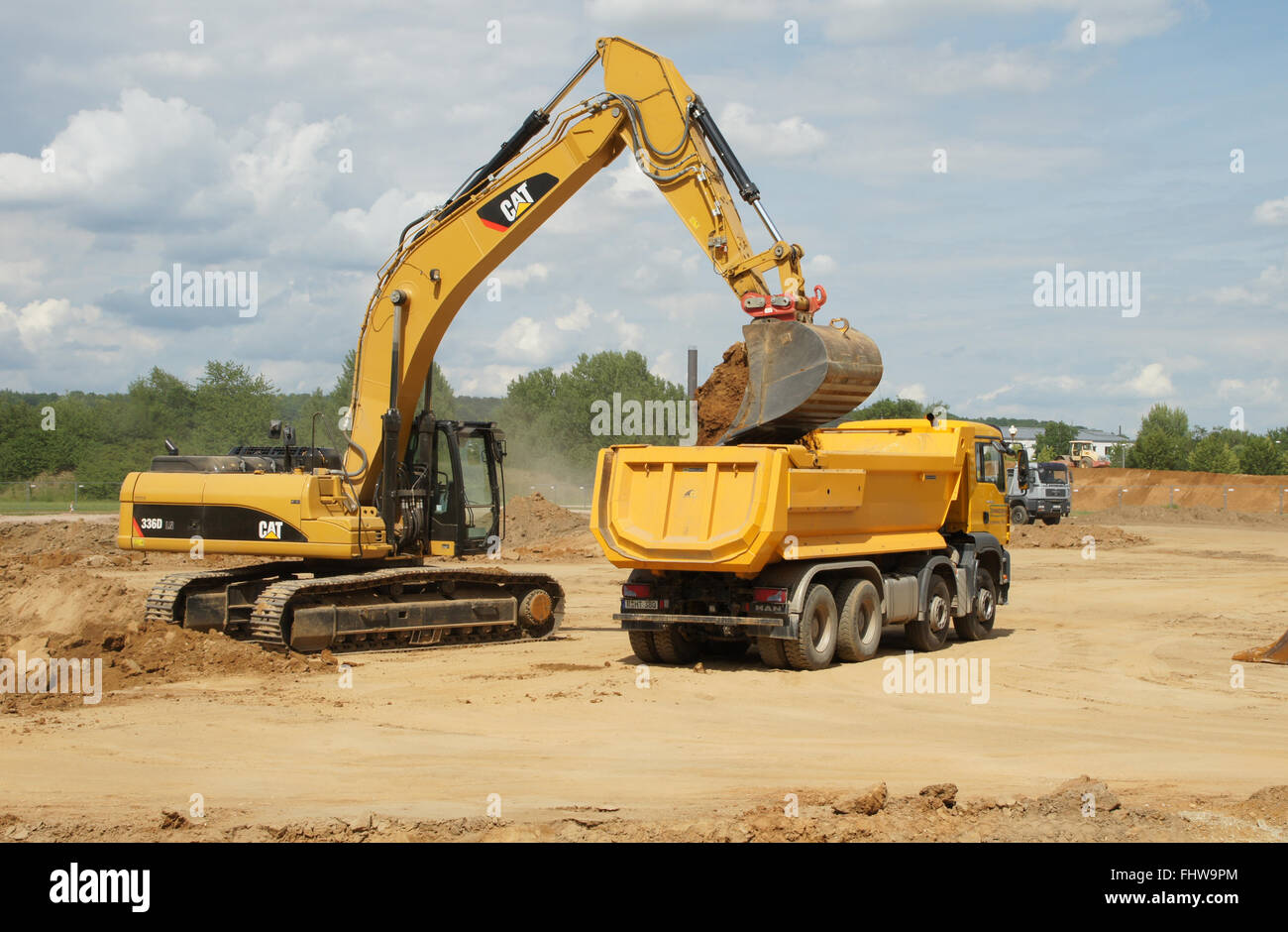 Building site with excavator and truck - Stock Image