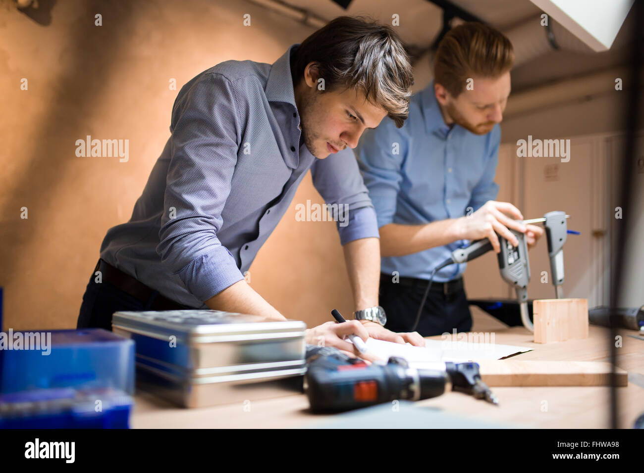 Industrial planning in workshop by creative people - Stock Image