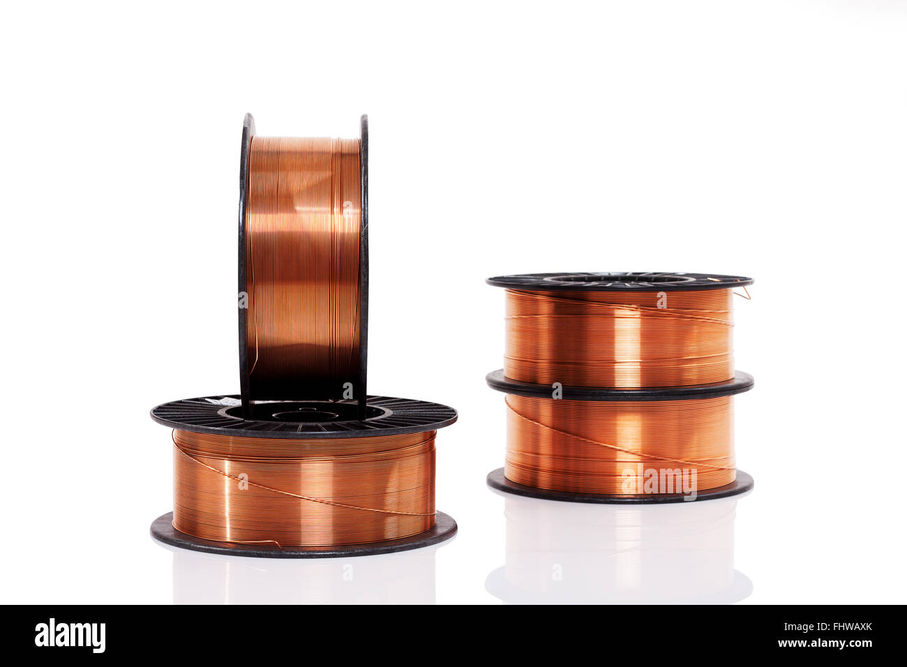 Copper welding wire wounded on the spools isolated on white. Wire ...