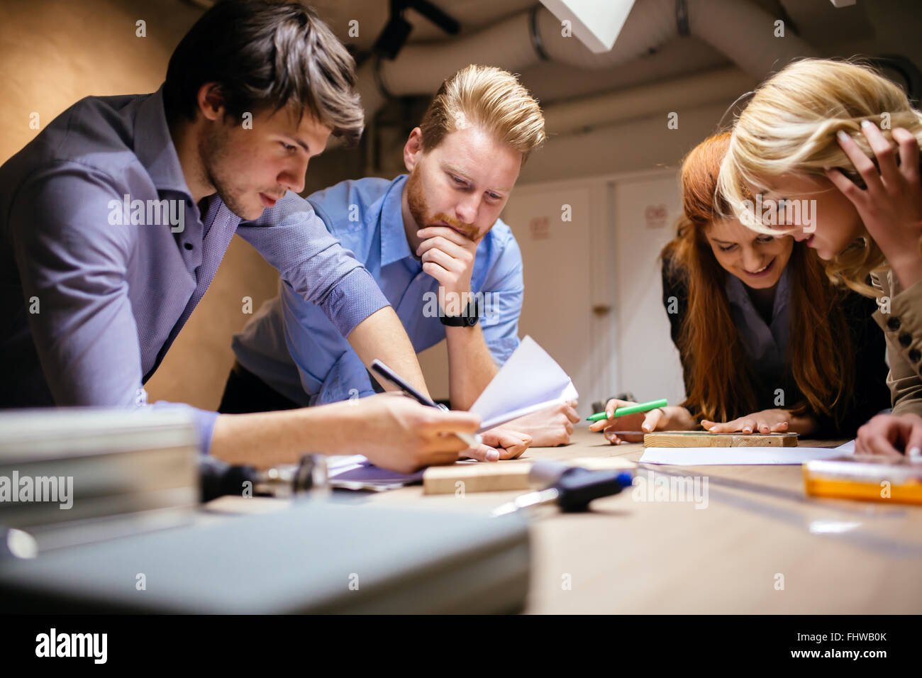 Group of creative designers brainstorming and working on a project - Stock Image