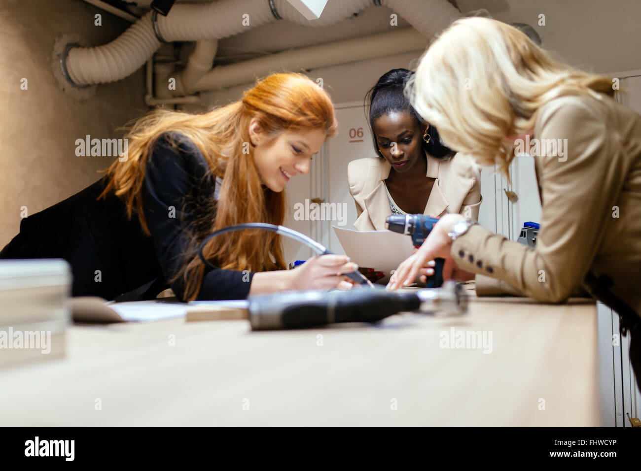 Group of designers working on a project as a team - Stock Image